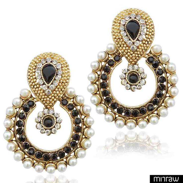 Pearl earring set in a traditional shape glows with warmth of pearls and the ethnic flavour of designs. Black stones add elegance.