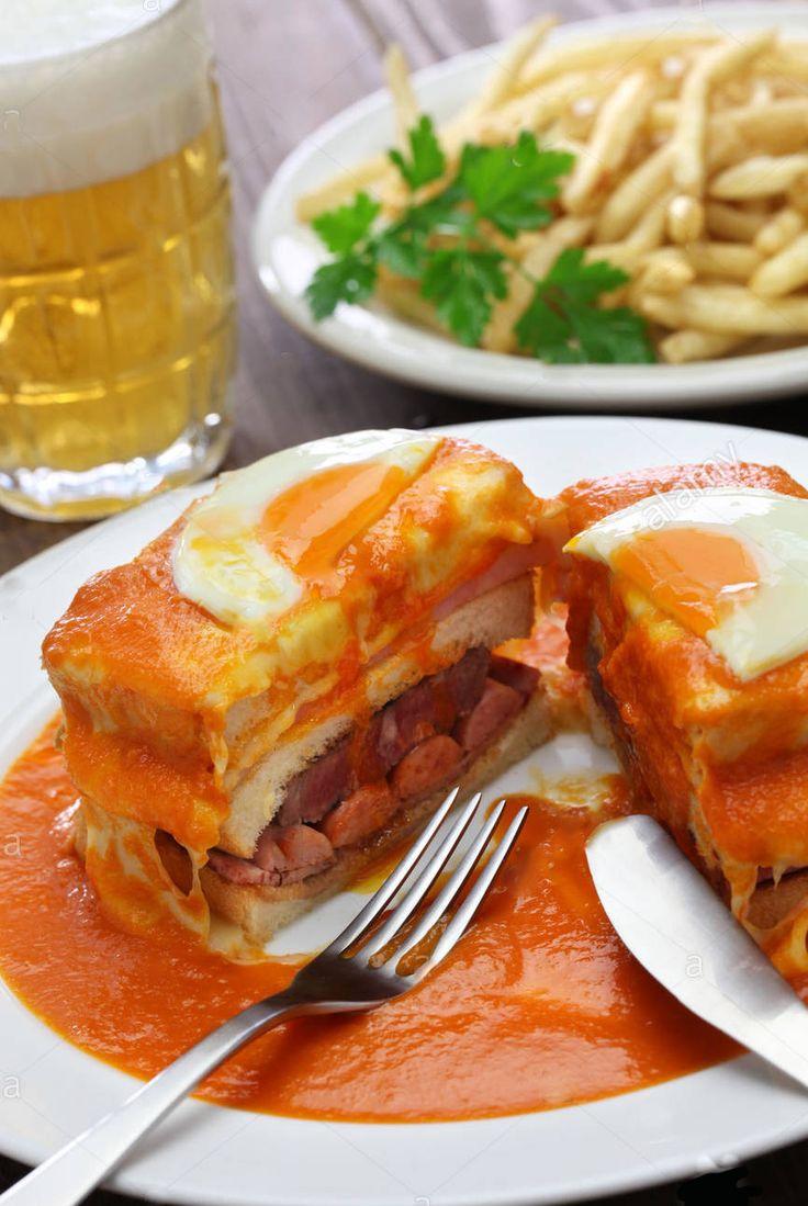 Francesinha  É um prato típico e originário da cidade de Barca, localizada no Porto, em Portugal.  Tem a forma de uma sanduíche e é constituída por linguiça, salsicha fresca, fiambre, carnes frias e bife de carne de vaca ou, em alternativa, lombo de porco assado e fatiado, coberta com queijo posteriormente derretido.   É guarnecida com um molho à base de tomate, cerveja e piri-piri. Os acompanhamentos de ovo estrelado (no topo da sanduíche) e batatas fritas são facultativos.   Com frequência…