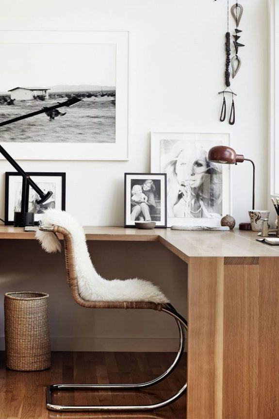 home office with black and white photos, wood desk and vintage desk chair with sheepskin. / sfgirlbybay