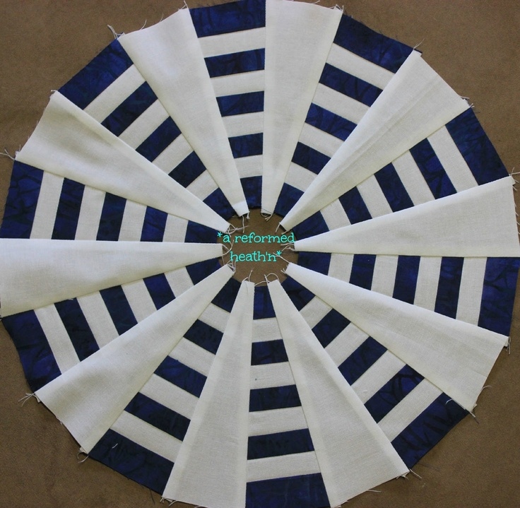 Looks nautical.The Dresden Plate quilt requires a lot of applique due to the circular pattern. Once finished, this quilt is colorful and beautiful. Make it from scraps of material or make a themed pattern quilt. Make the edges of the wedges pointed, rounded or use both ideas to make your Dresden Plate quilt block.