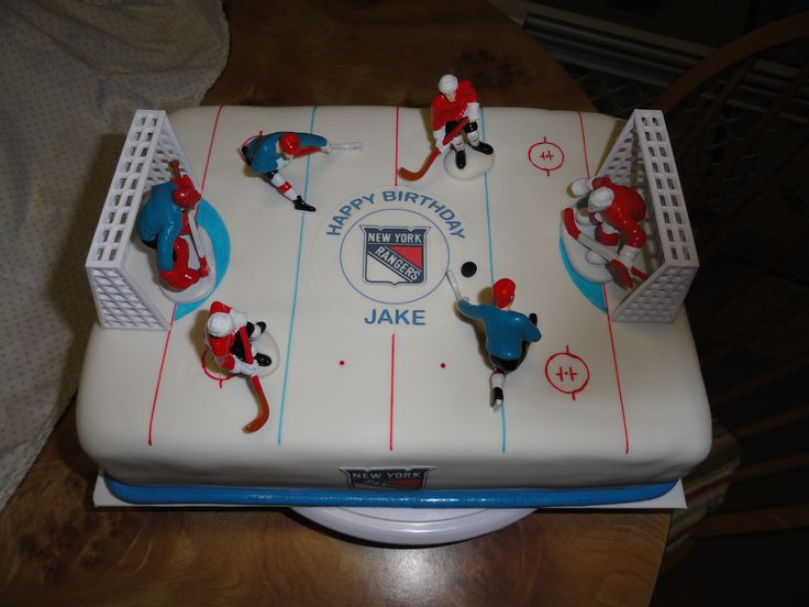 Happy Birthday Jake! - Yellow cake with chocolate pudding filling and iced in chocolate buttercream. Covered in fondant, center ice is an edible image & store bought hockey player kit.