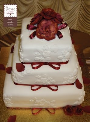 Eggless wedding cake. 3 tier with edible roses. To place your order visit http://www.preciousgemscakes.com.au