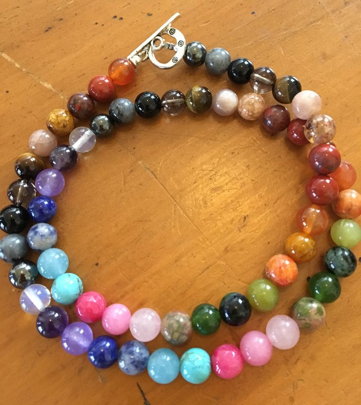 Chakra Necklace with 21 Different Gemstones $39.99 (16-18 inches - your choice) please message to order. These bracelets make great gifts  Chakra jewellery is designed to balance the seven chakras, which are said to be energy centers used for centuries by Indian and Eastern cultures. They usually consist of seven stones or charms in different colors or designs, each component representing one of the chakras — crown, brow, throat, heart, solar plexus, sacral and base.