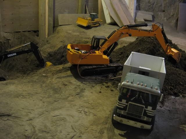 Hobbyist Excavates Basement With RC Model Construction Equipment.