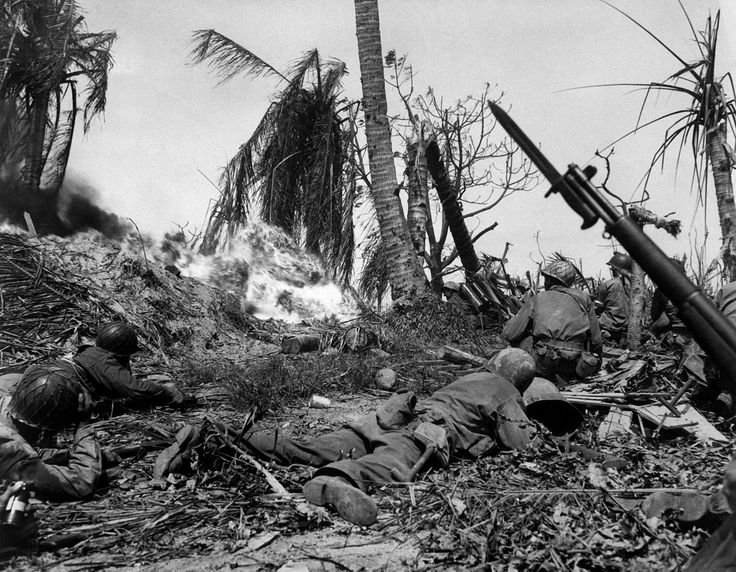 Soldiers of the U.S. 7th Infantry Division attack a Japanese blockhouse on Kwajalein Atoll (February 1944).