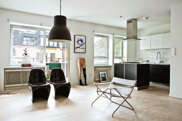 A bit of attitude!  Black and white living room / kitchen Verner Panton S chair