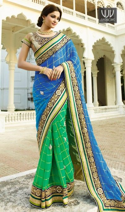 Celestial Royal Blue And Green Colored Georgette Saree Get Your Hands On This Amazing Red Colored Georgette Saree, It Has A Tint Of Pink In The Skirt And Is Paired With A Beige Colored Dupion Blouse.