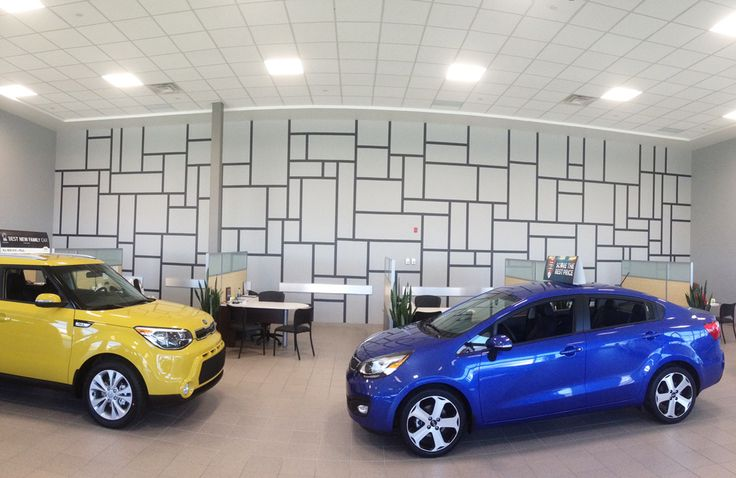 Dilawri Motors Kia dealership had a giant wall that required something unique. This line design was decided upon to keep it somewhat simple yet interesting as well. Hand painted by Mural Magic in Ottawa. With a lot of tape!