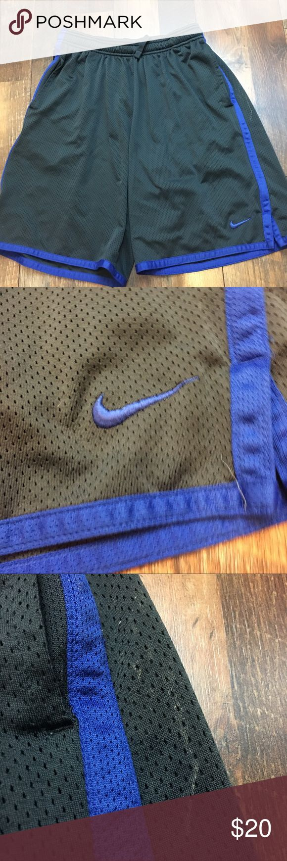 Nike Dri Fit Basketball Athletic Shorts Nike Dri Fit men's shorts size large in good used condition with a stain on the side as seen in pictures. Nike Shorts Athletic