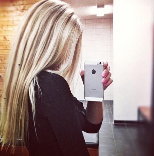 Pale-bright blonde heavy highlights (on naturally light brown or dark blonde hair) with thin medium brown lowlights