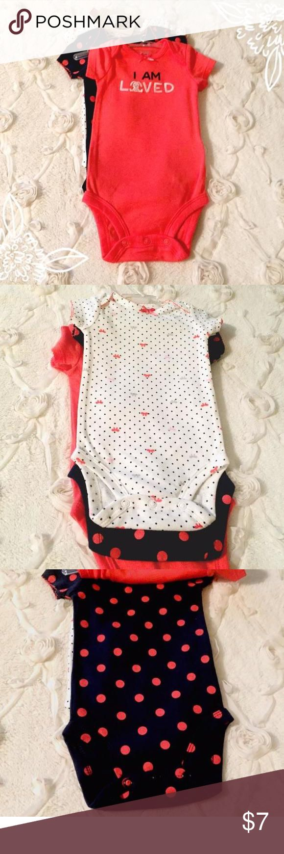 "NWT I Am Loved Set New with tags child of mine Carters set of three onesies, one bunny ""I am loved"" onesie, a navy blue with coral polkadots onesie, and a white onesie with polkadots and bows. Size 0-3 months Carters Dresses"