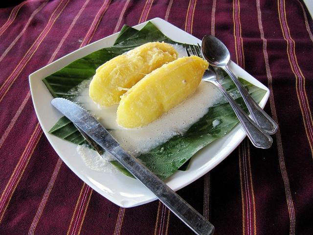Burmese Wrapped Bananas (Kauknyintok). Bananas steamed in a banana leaf with coconut cream and sesame seeds.