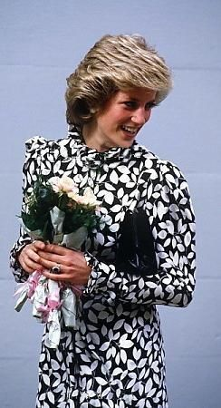 Princess Diana in a black and white floral print dress, circa 1985 or 1986..Princess Diana also wore this to a polo match 1985...