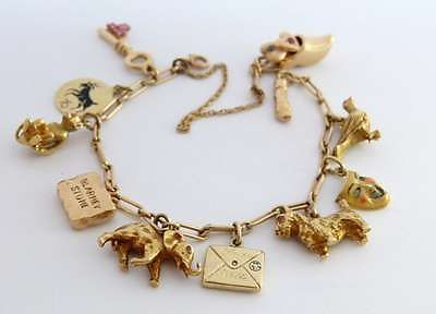 Wert: 28.200,00€  antikes 20er Cartier Armband Gold Bettelarmband mit  11Charms