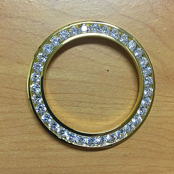 Hand set bezels for 41mm. watches and timepieces.(GREAT FOR Jewelers and 41mm watches such as DAY-DATE 2,AND DATE-JUST 2) Very high end, hand set individually cz's and lab diamond simulated vvs1. high end real gold and rhodium finish.PICK CHANNEL SETTING http://www.buzzblend.com