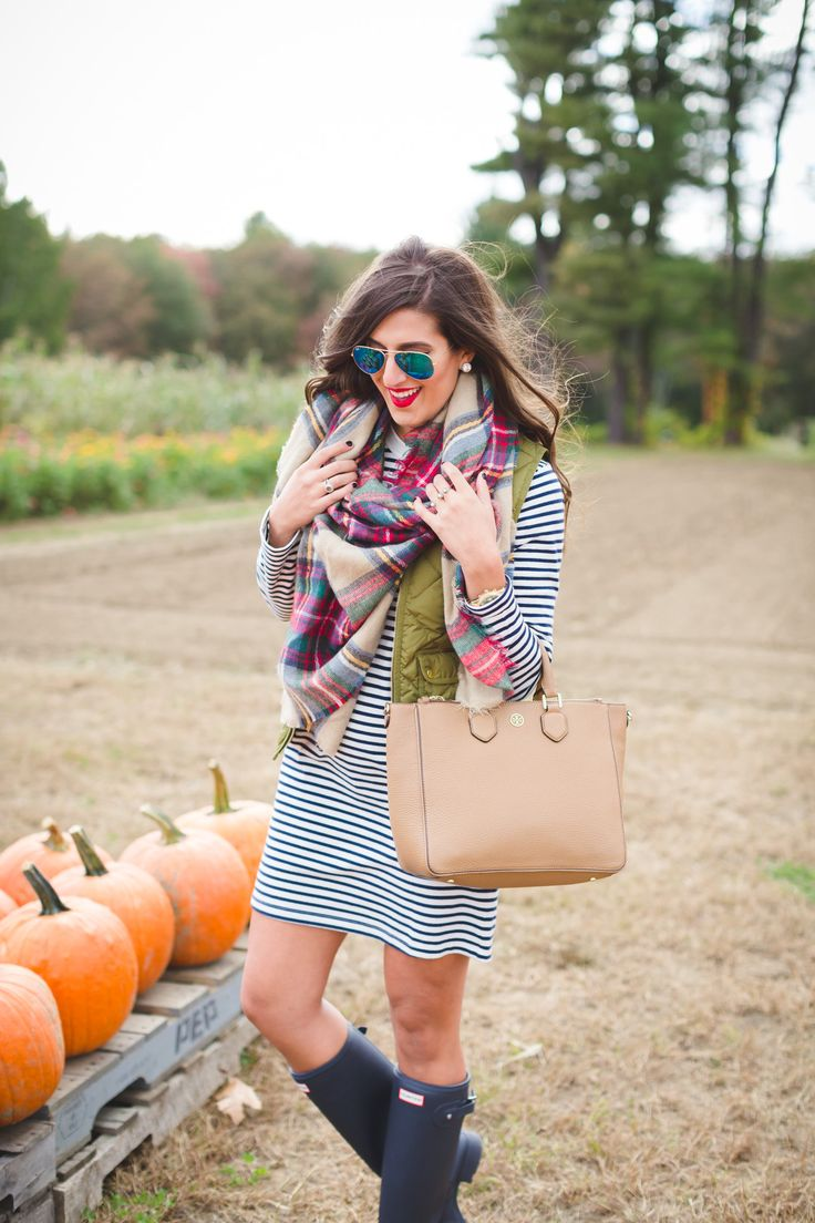 plaid blanket scarf, fall preppy outfit, quilted vest, excursion vest, stripe dress, hunter boots, fall blanket scarf, fall outfit ideas // grace wainwright from a southern drawl
