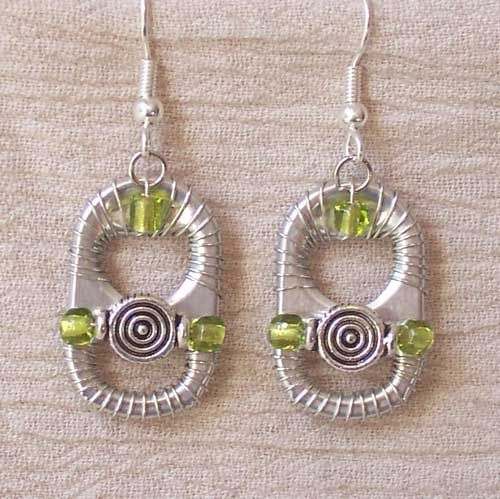 Earrings are handcrafted using recycled soda can tabs.