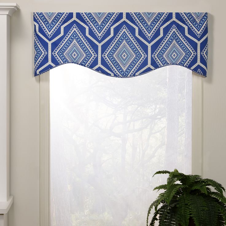 Dress up your window with this attractive M-shaped valance. It features an elegant geometric pattern in blue. Matching daybed is available, sold separately.