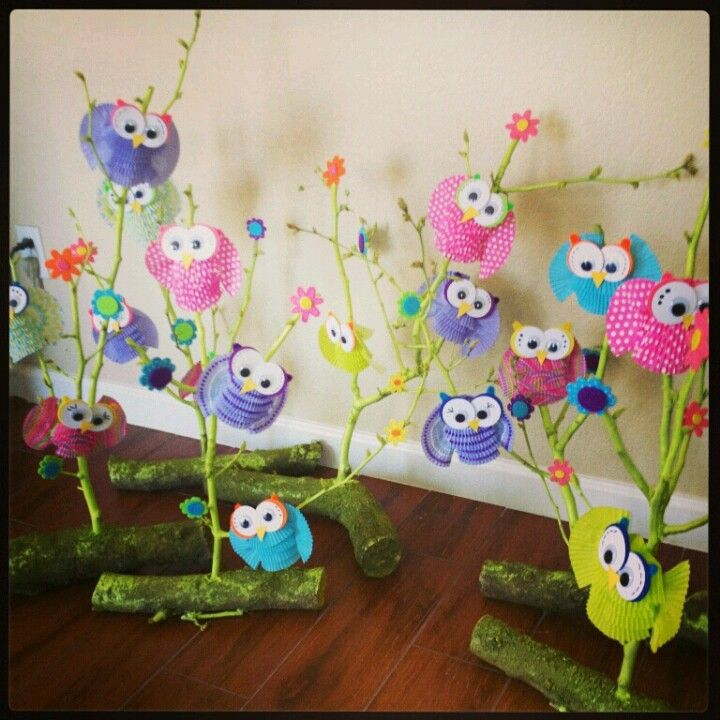 I made these out of cupcake liners and branches from my tree for an owl themed birthday party.   Diana Eaton