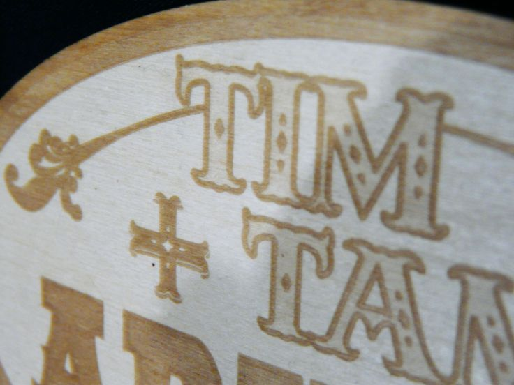Closeup of laser-cut baltic birch showing the shading levels possible with laser-engraved designs. This was a custom rustic wedding cake topper created by Lazerworx.