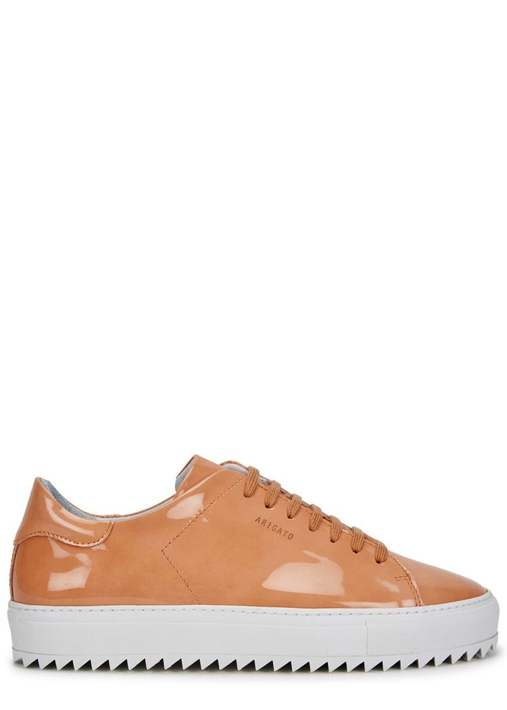 UK exclusive to Harvey Nichols  Handmade  Axel Arigato camel patent leather trainers Flatform measures approximately 1 inch/ 25mm Gold designer stamp, white serrated rubber sole, round toe  Lace-up front  Come with a dust bag