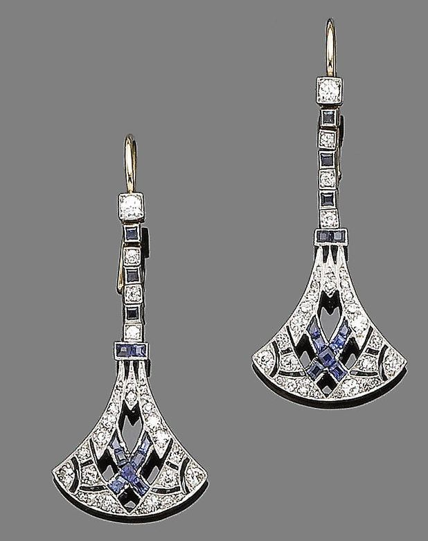 An early 20th century Art Deco pair of sapphire & diamond pendent earrings.  Of openwork inverted lotus shape, millegrain-set throughout with old brilliant & single-cut diamonds & calibré-cut sapphires, to an articulated line surmount of old brilliant-cut diamonds & square-cut sapphires, diamonds approx 1.00 ct total, later fitting, length 4.6 cm.