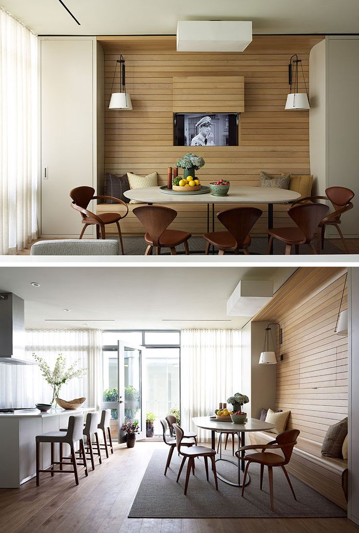 In this apartment, the television was placed behind a panel within the walnut…