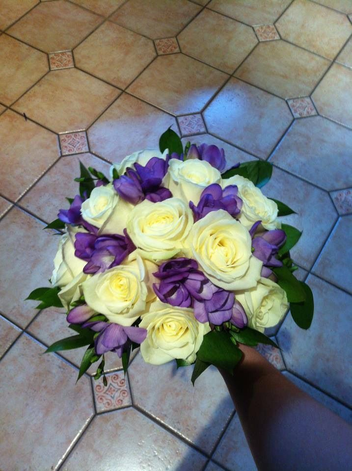 Avalanche roses, purple freesias and hard Ruscus