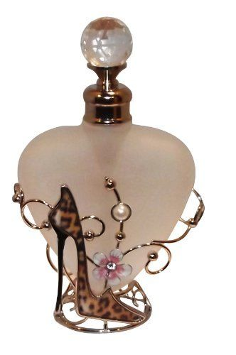 """Leopard Style Shoe Perfume Bottle by Welforth. $18.95. Beautiful Leopard Shoe perfume bottle is decorated with flowers and silver vines. Holds approximately 4 ounces of your favorite fragrance. Size 4.5"""" high by 3.5"""" wide. Tempered opaque bottle with screw top."""