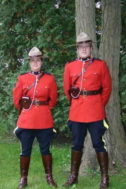 """RCMP officers in """"dress"""" red serge"""