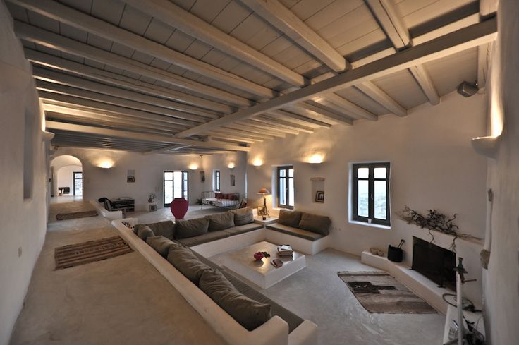 The heart of the house is the living room. In this case it is huge, but smartly divided in levels and smaller areas. The wooden ceiling warms up the room.