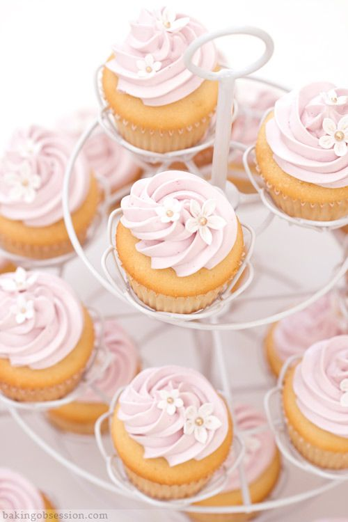 Lemon cupcakes with raspberry frosting. Frosting recipe looks delicious!! Website is really nice for other recipes too <3 http://www.bakingobsession.com