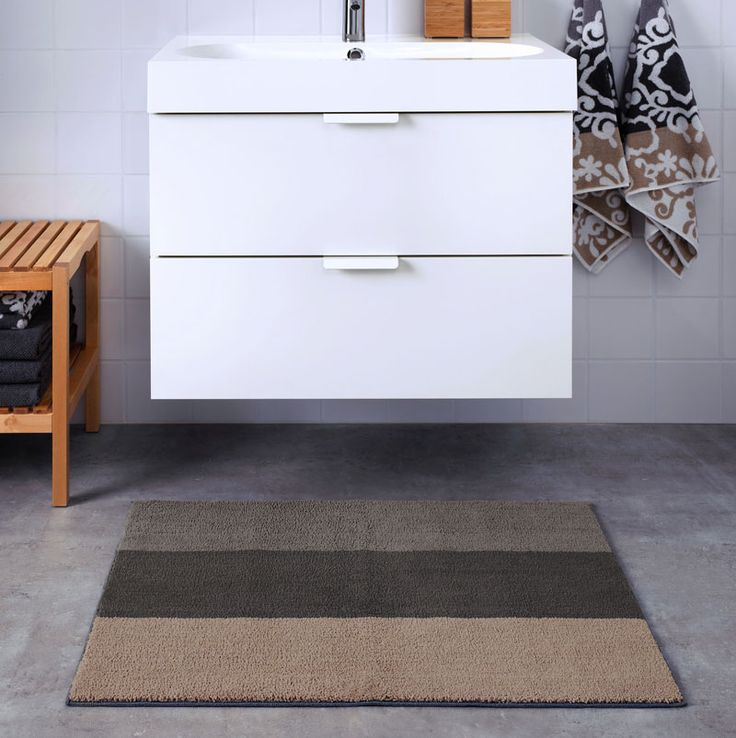 13 Ideas For Creating A More Manly, Masculine Bathroom // This mat with neutral colors is great because it can go with pretty much any masculine color scheme.