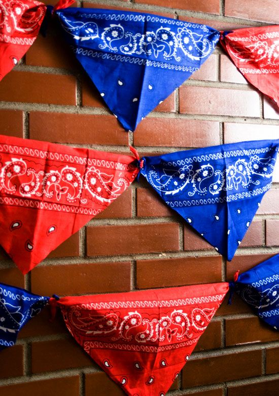 It doesn't get any easier than this.  Bandannas, cut into four triangles and tied together at the corners.  Cute western party decor on the cheap.