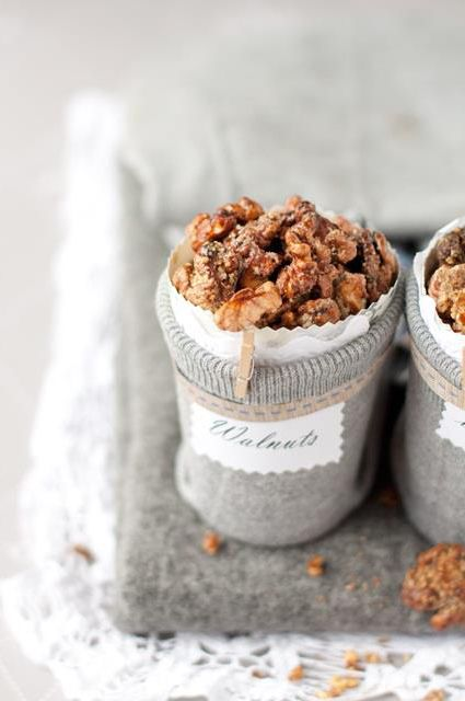 holiday gift idea: wrap a mason jar in a sweater/knitted sleeve, add paper doily & caramelized walnuts ..