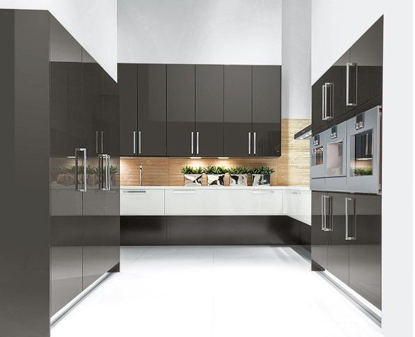 Charcoal gloss kitchen in a modern  uncluttered slab style.