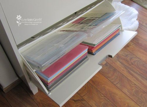 Ikea Shoe Organizer fits two 12 x 12 stacks of paper side by side. Brilliant!