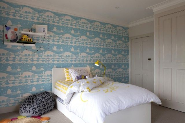A little boy's room that is both calming and fun