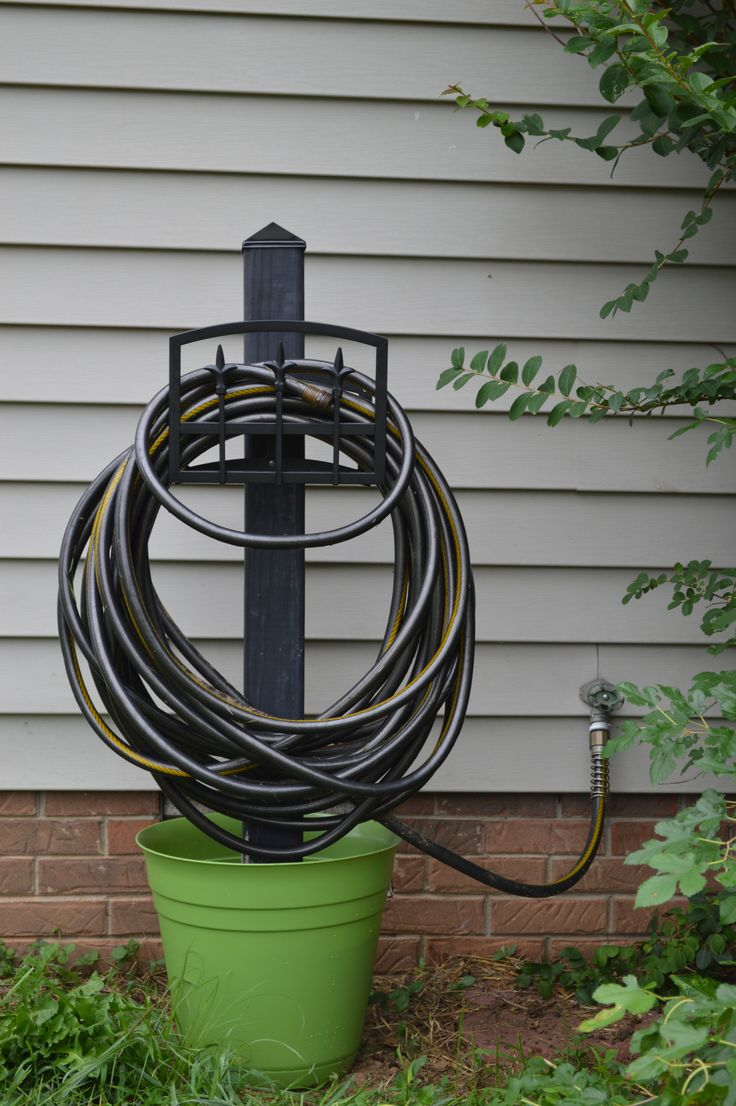 Best 25 water hose holder ideas on pinterest garden for Diy garden hose storage