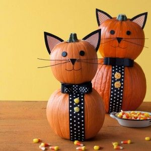These charming cats are an easy Halloween craft.   Video: Watch the step-by-step to create these pumpkins! »