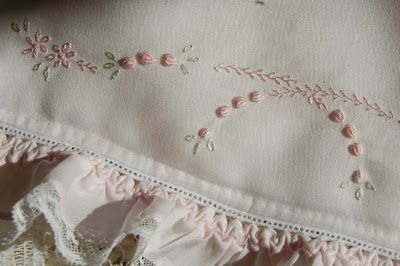 the embroidery on the Bonnet shimmers because it is Silk Floss