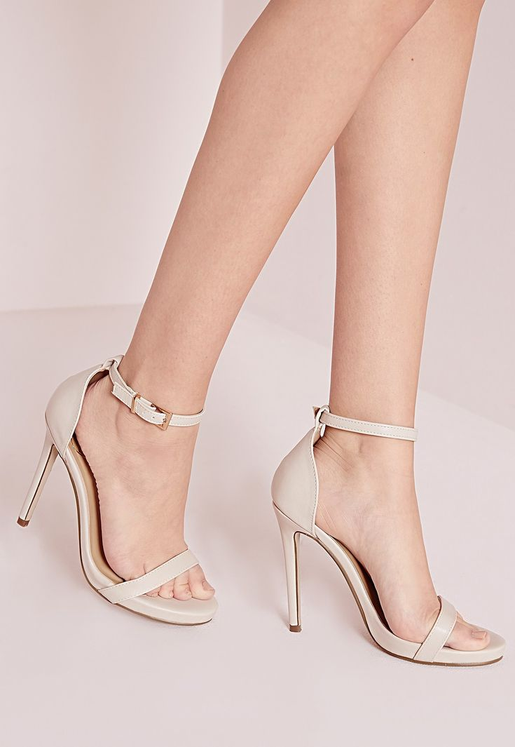 As well as these lush nude heels being fierce they are also super comfortable with built in padding so you can keep dancing all night! We're loving these barely there sandals with ankle strap detail teamed with a white dress for a fresh min...