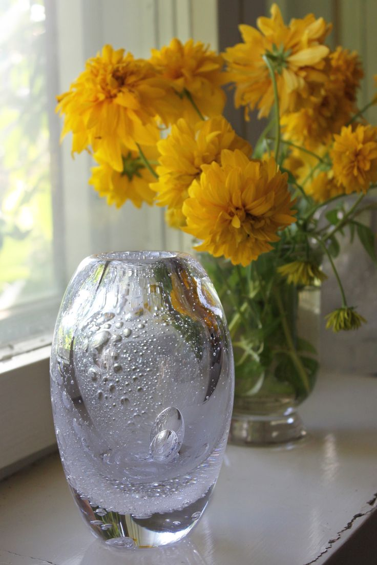 "Jokihelmi ""River pearl"" mouth blown glass vase by master glassblower Kari Alakoski. The Glass studio Mafka&Alakoski works in a premises of a former glass factory in Riihimäki, Finland."