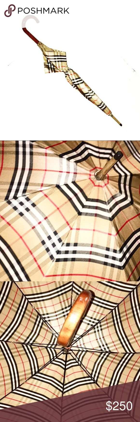 "Authentic Vintage Burberry Nova Check Umbrella Authentic Burberry Vintage Nova Check Walking Umbrella  Hallmark:Burberry's Wooden Handle & Tip with Polyamide Nova Check Material  Length 34"" Diameter is 42"" when Open Burberry Accessories Umbrellas"