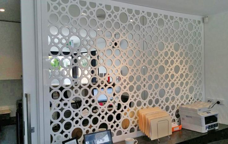 Decorative screens are a beautiful solution to creating work spaces in your home or business office. This is the lovely 'Capri' circular design used to divide an office.