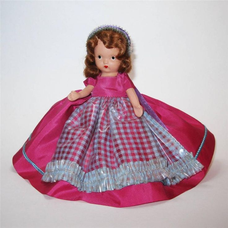 """Nancy Ann Storybook Bisque Doll 176 """"Nellie Bird"""".  Her plastic apron appears to be intact."""