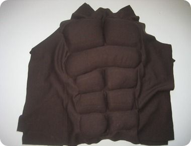 how to sew a muscle shirt- this worked surprisingly well.  I used an old piano bench cushion we had kicking around