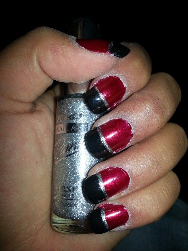 Red manicure with silver detail.