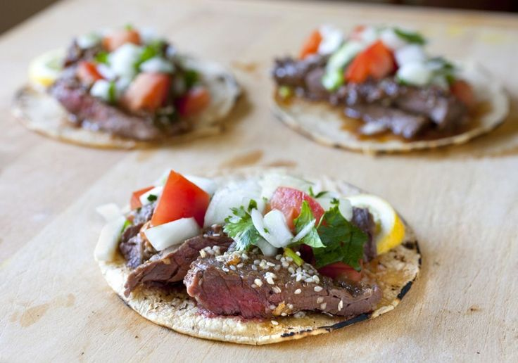 """Since Korean food works great with Tex-mex I wanted to try Korean-style tacos again! Usually """"kalbi"""" refers to Korean BBQ short ribs but I really wanted to try the kalbi marinade on skirt steak since it's a great meat for tacos. The marinade consists of ginger, soy sauce, sesame seeds, and asian"""