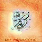 Tartarughe e maiuscola B con scintille idea tattoo diyartcraft.it